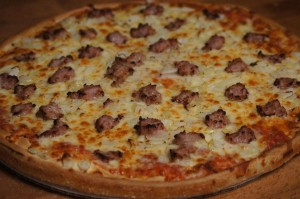 arge pizza with onions and sausage