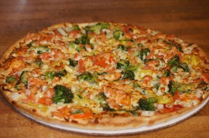 onion,tomatoes,broccoli and banana peppers pizza