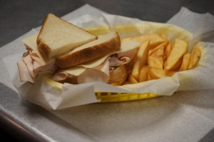 turkey sandwich on white with steak fries