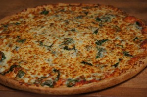 cheese pizza with fresh spinach