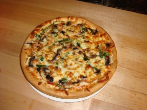 white pizza with mushroom and fresh spinach
